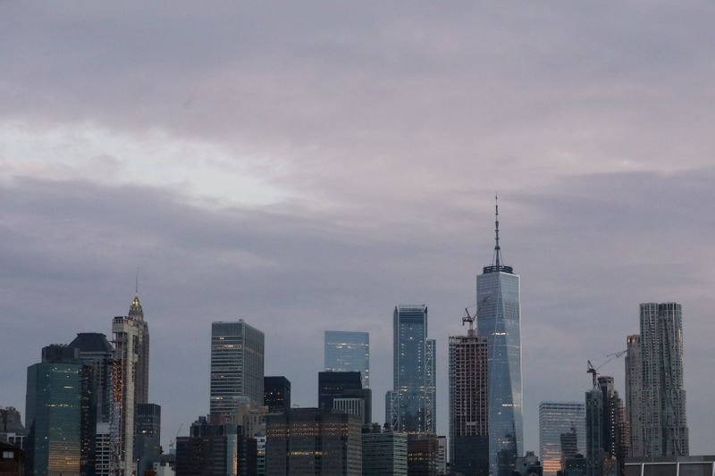 The skyline of lower Manhattan is seen before sunrise in New York
