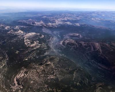 Smoke from wildfires hangs low in the valleys of the Uinta Mountains in eastern Utah