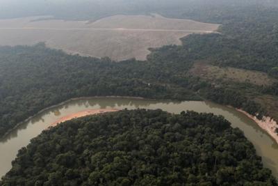 FILE PHOTO: FILE PHOTO: al view shows a river and a deforested plot of the Amazon near Porto Velho