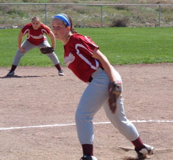 Joel Harding photo Ari Salcido pitches. Allysa Hansen is ready  at shortstop.