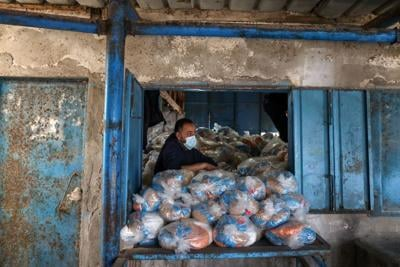 Palestinians receive food supplies at UNRWA distribution center in Gaza