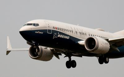 FILE PHOTO: FILE PHOTO: A Boeing 737 MAX aircraft lands during an evaluation flight in Seattle