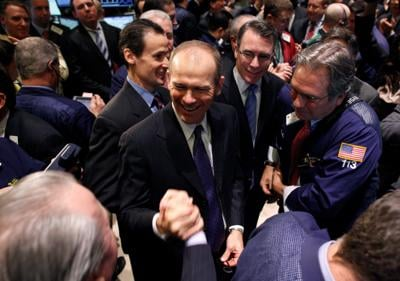 FILE PHOTO: David Calhoun is congratulated after his company's IPO opened on the floor of the New York Stock Exchange