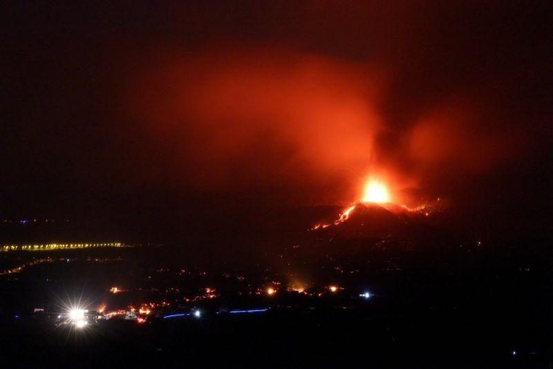 Lava and smoke rise following the eruption of a volcano on the Island of La Palma