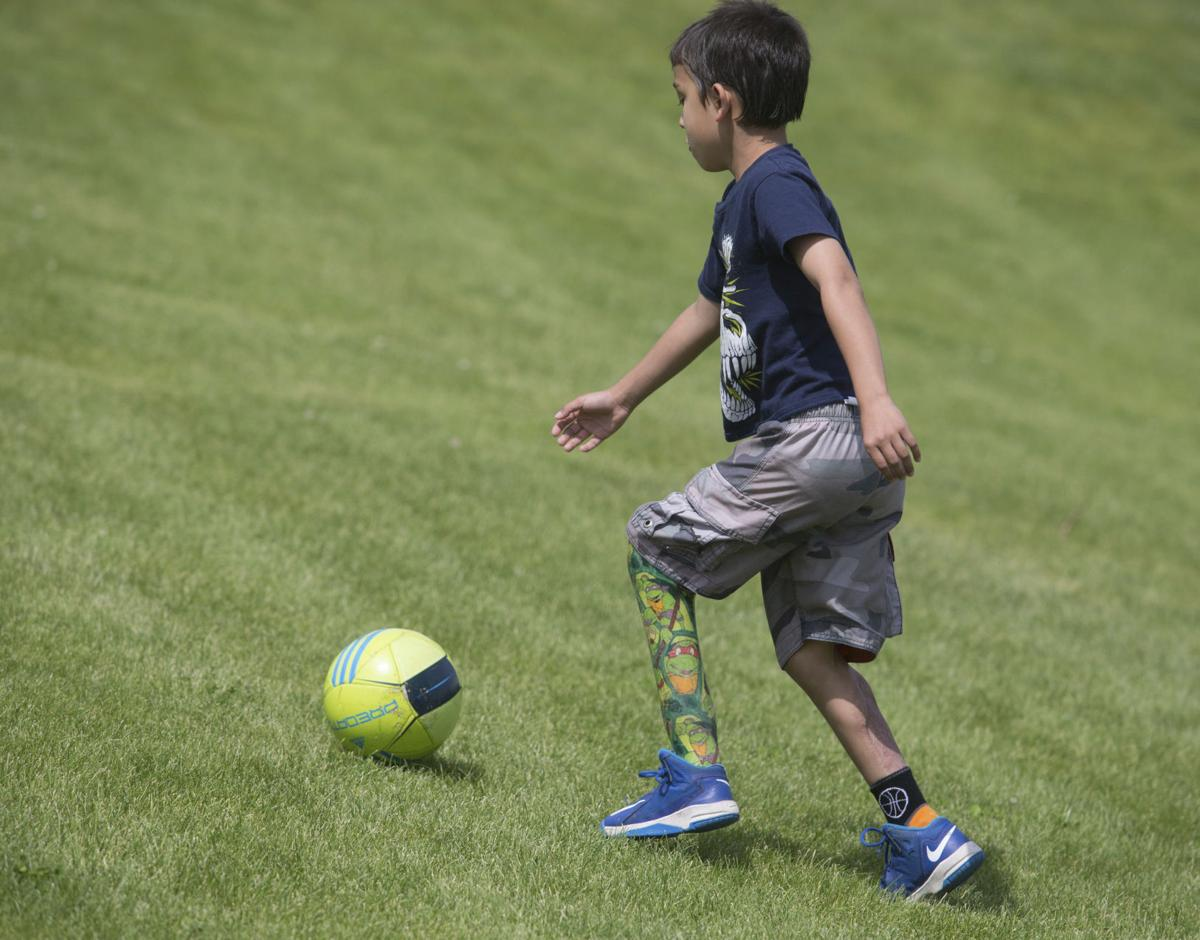 Recovery from lawn mower accident shows spirit of boy, 9