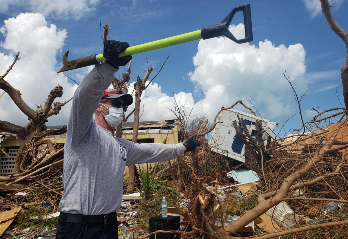 Chad Belger leads a search for the dead in the destroyed Abaco shantytown called Pigeon Peas
