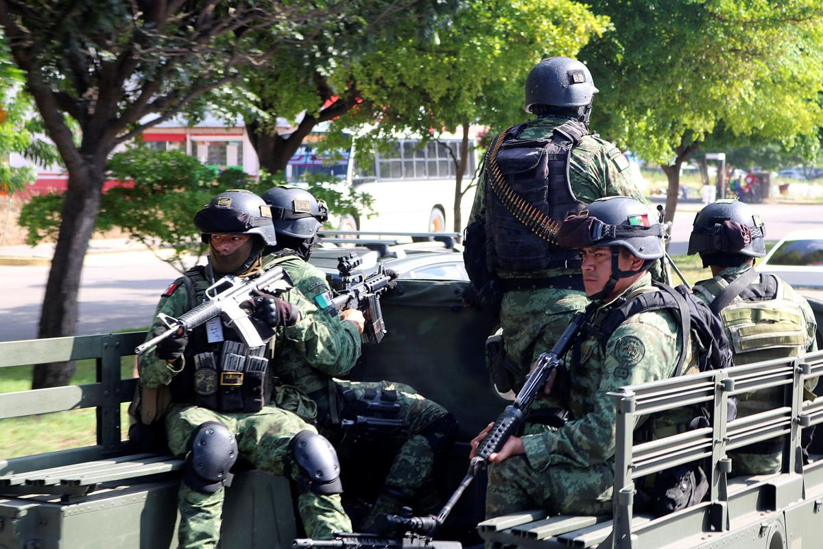 Special unit of Mexican Army conduct patrol after cartel gunmen clashed with federal forces in Culiacan