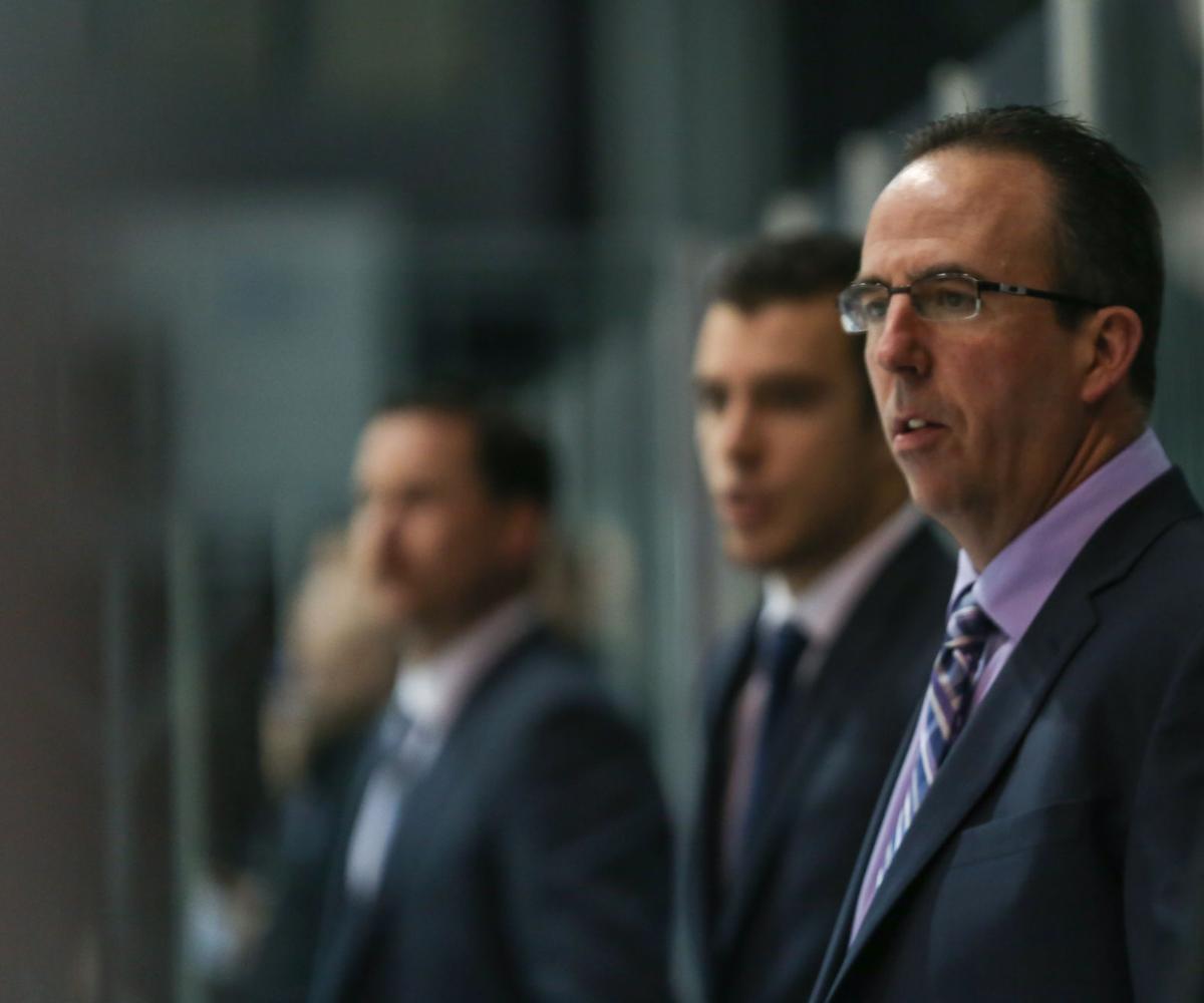 Clarke Singer coach of men's hockey team