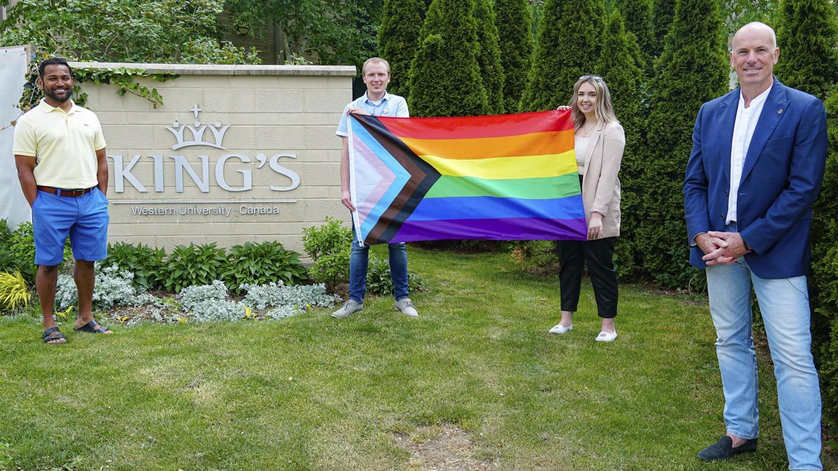 King's raising Pride flag