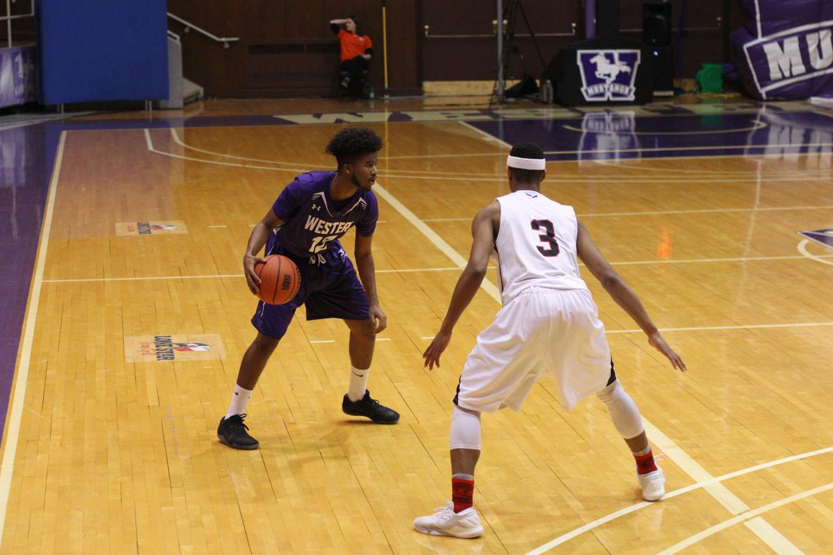 Omar Shiddo men's basketball versus Carleton
