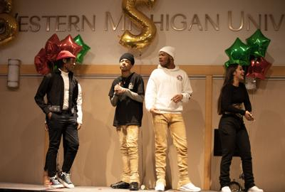Four models take the stage at the end of the Black Love Fashion show.