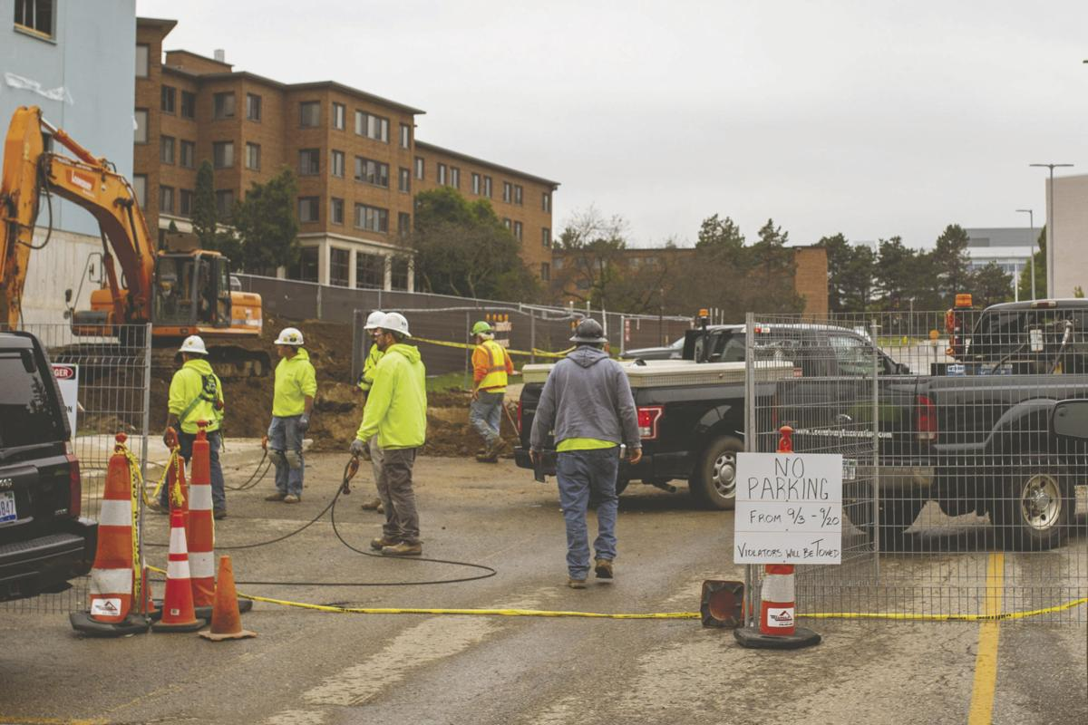 Workers at the site of the ongoing Arcadia Flats project