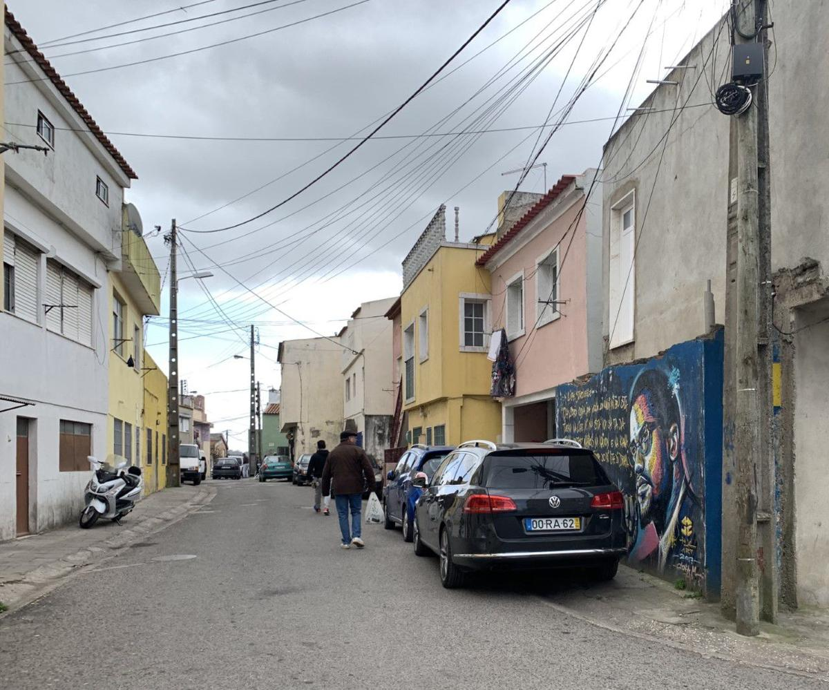 A mural of Malcolm X is painted along a street in Cova da Moura, one of Portugal's lower income neighborhoods.