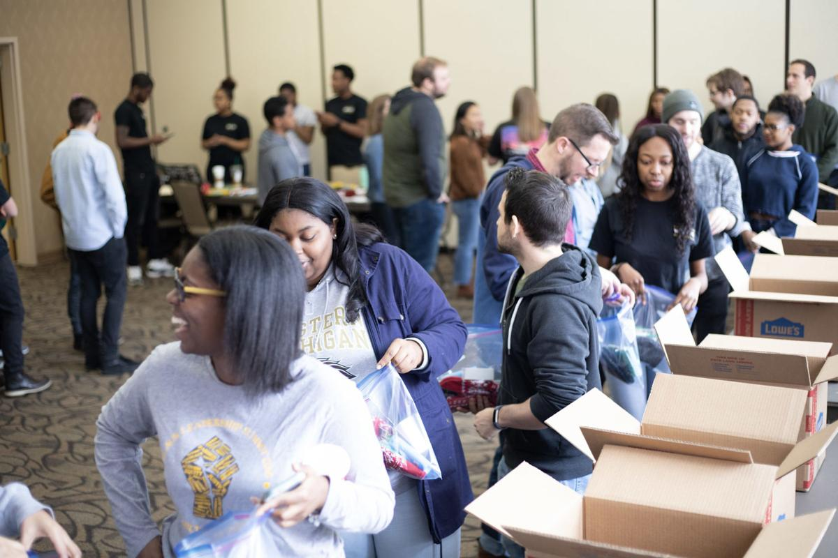 Students lined up to help BSU fill packages for the homeless which included hygiene and basic necessity items.