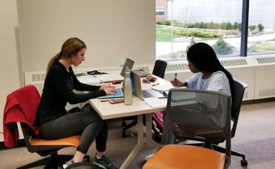 Kaela Wunderlich and Kyra Barnes study in the Waldo Library