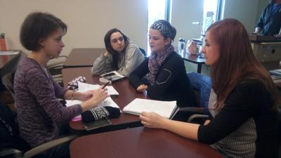 Students in a classroom at Brown conducting group work