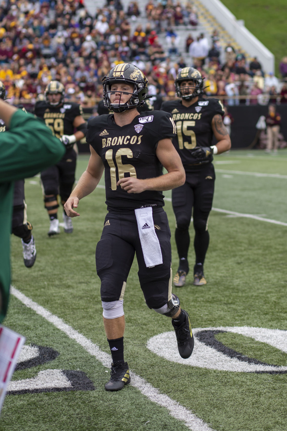 Quarterback Jon Wassink jogs to the sideline during a timeout while up 10-0 against the Central Michigan Chippewas.