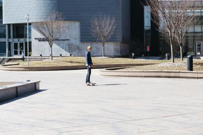 With very little foot traffic on the sidewalks of WMU's campus, students on wheels take advantage of the empty space.