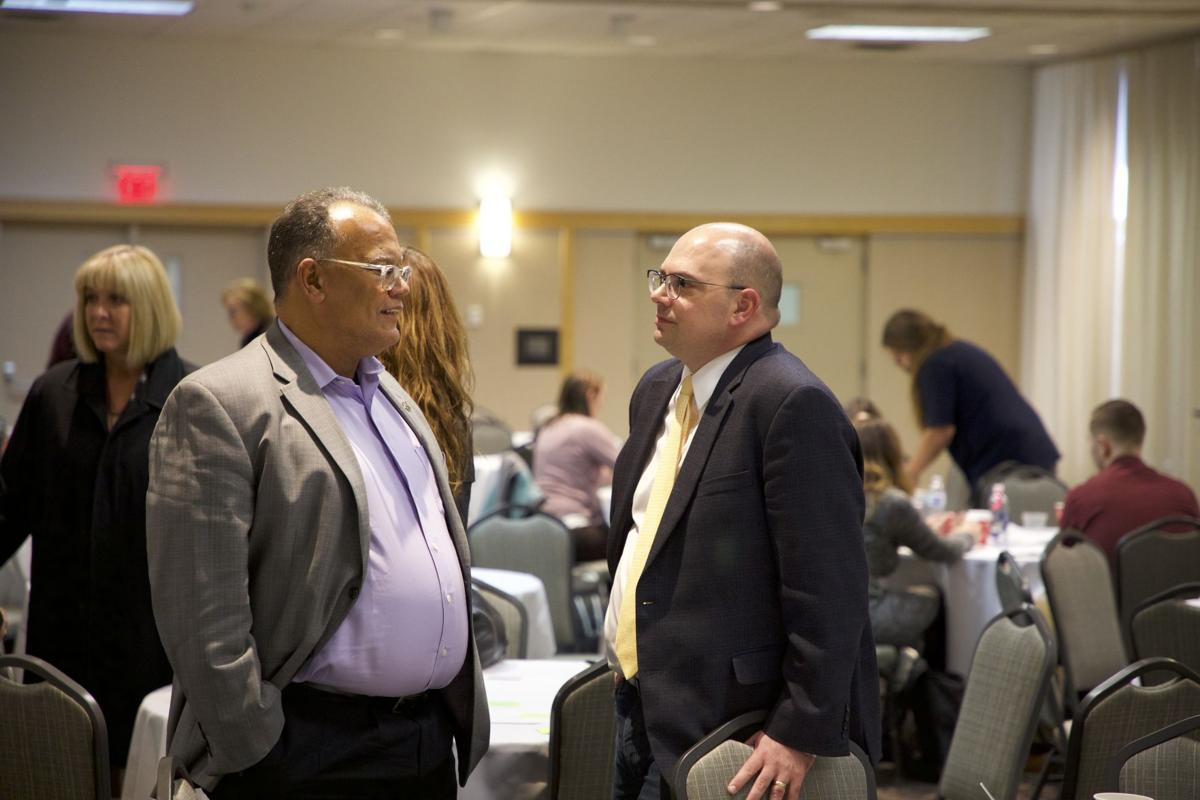 WMU President Dr. Edward Montgomery and vice president of marketing and strategic communications Tony Proudfoot meet after WMU's Think Big town hall event.