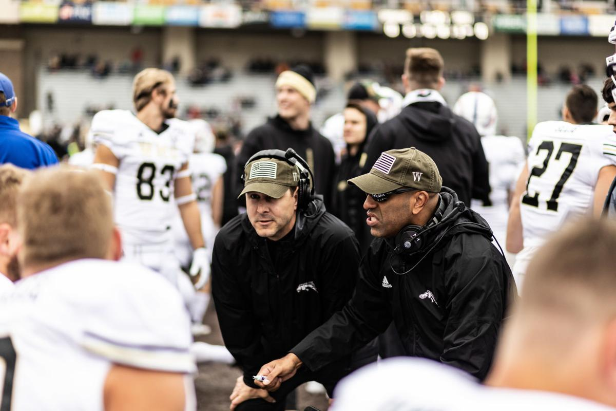 Head coach Tim Lester and offensive coordinator Jake Moreland