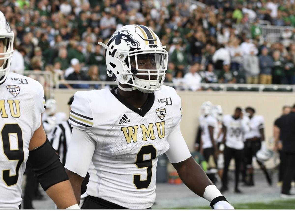 Najee Clayton approaches mid field for coin toss vs. Michigan State in 2019.