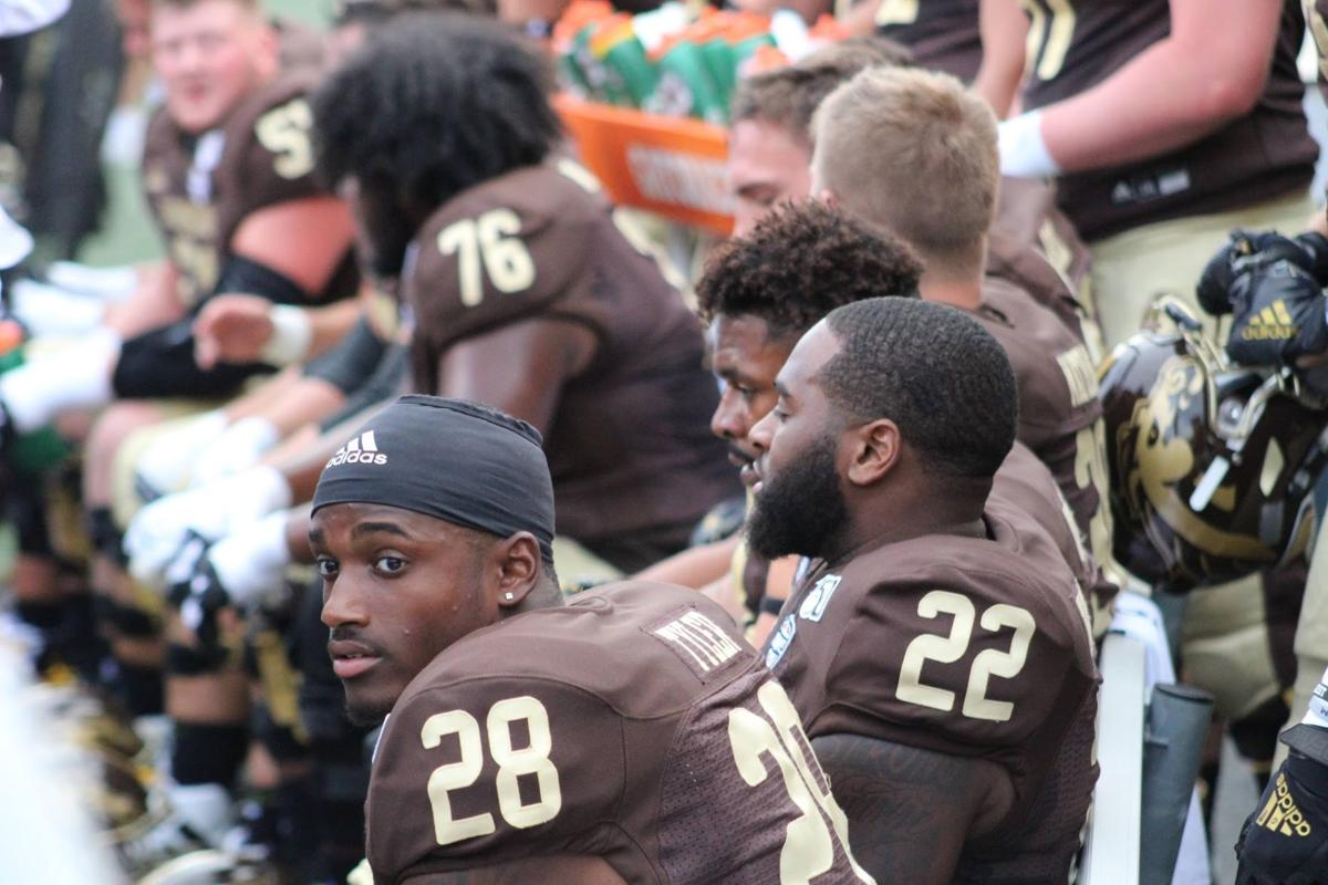 Freshman running back Sean Tyler watches as his team adds to their already impressive lead