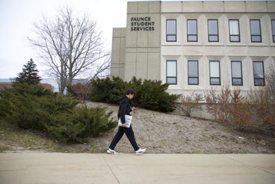 Samuel J. Robinson walks out of Faunce Student Services