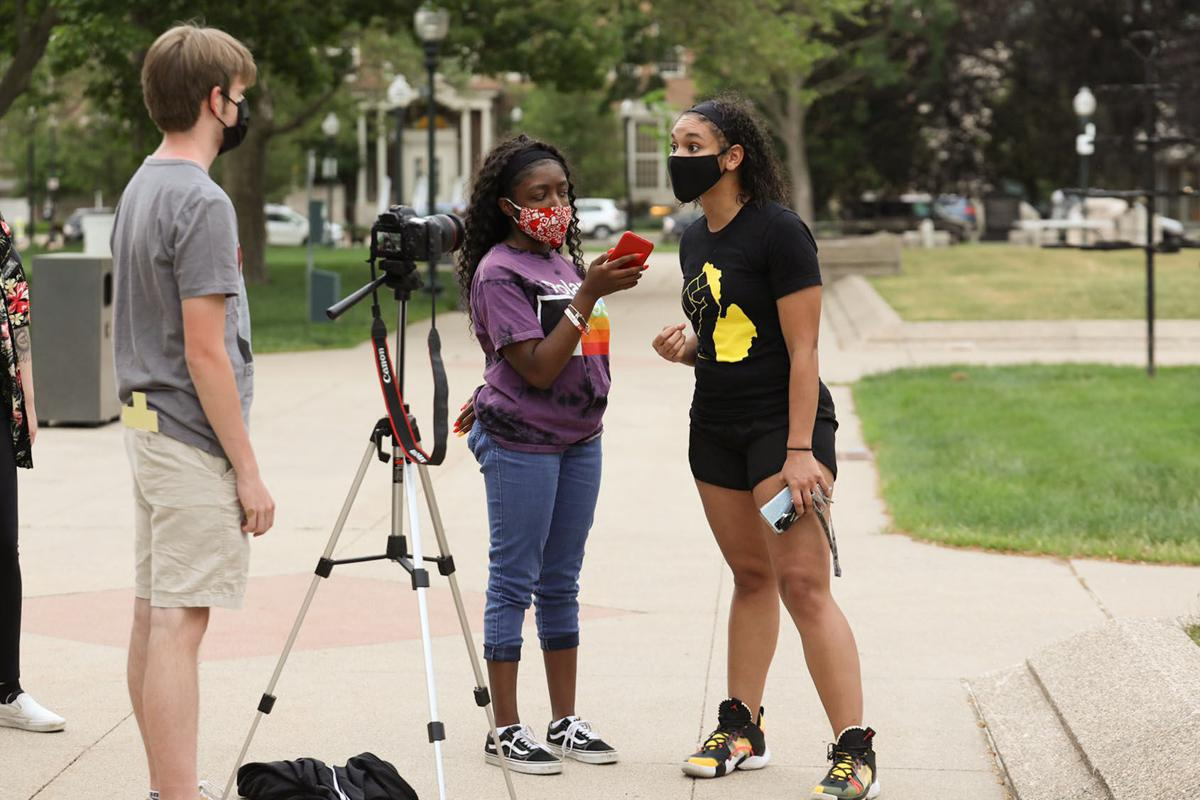 News Editor Destini Lindsey interviews an activist at a memorial for George Floyd in Bronson Park.
