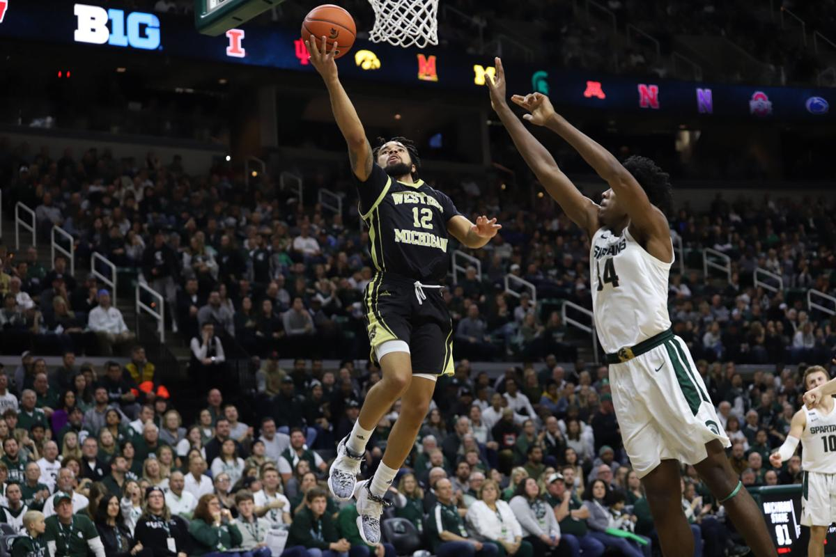 Junior guard Mike Flowers goes up for a layup over the top of Michigan State's Xavier Henry