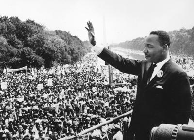 """Civil rights leader Dr. Martin Luther King Jr. waves to supporters August 28, 1963 on the Mall in Washington, D.C. during the """"March on Washington."""""""