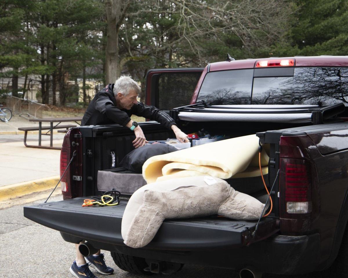 Steve Schmidt packs for his son, Jalen, outside of Hadley Hall.