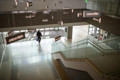A passerby walks through WMU's Sangren Hall.