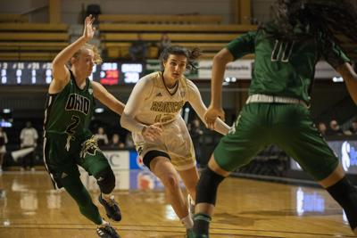 Junior forward Reilly Jacobson moves past