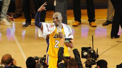 Kobe Bryant wishes the Staples Center crowd farewell after scoring 60 points in the final game of his NBA career.