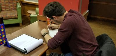 English major Chris Carr studies in a cafe.