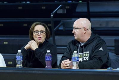Kathy Beauregard and Steve Hawkins inside University Arena to watch WMU women's basketball's senior day game.