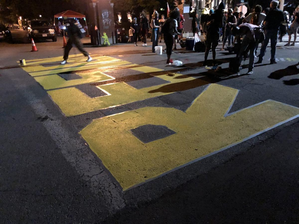 Protesters painted RESIGN on the street in front of Krewson's house