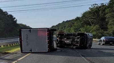Child injured after truck carrying a camper rolls over on Mass Pike in Warren.
