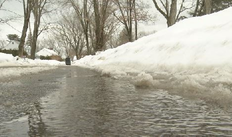 Heavy rain, melting snow leads to street flooding
