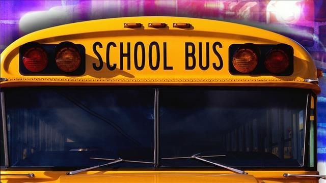 Four hospitalized after crash between school bus and car