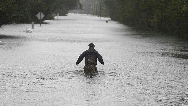 Florence leaves at least 15 dead, days of flooding ahead