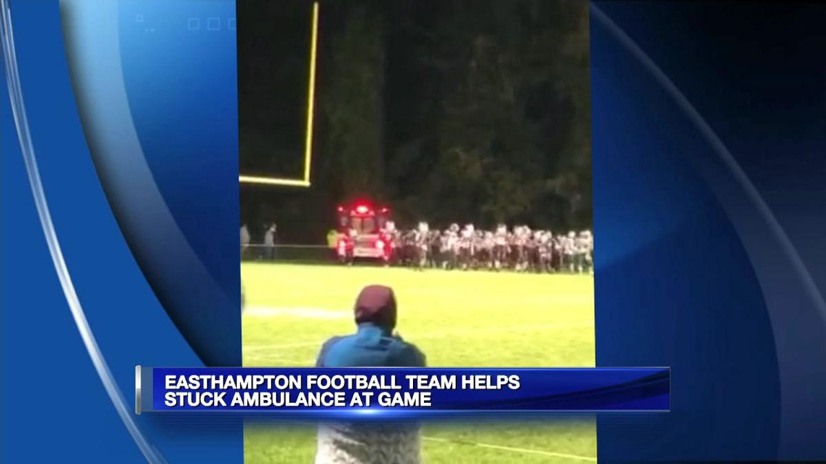Football players spring into action after ambulance vehicle becomes stuck