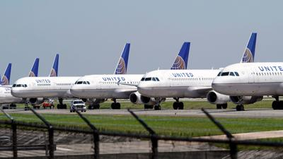 United Airlines workers protest potential layoffs after company received billions in Covid relief