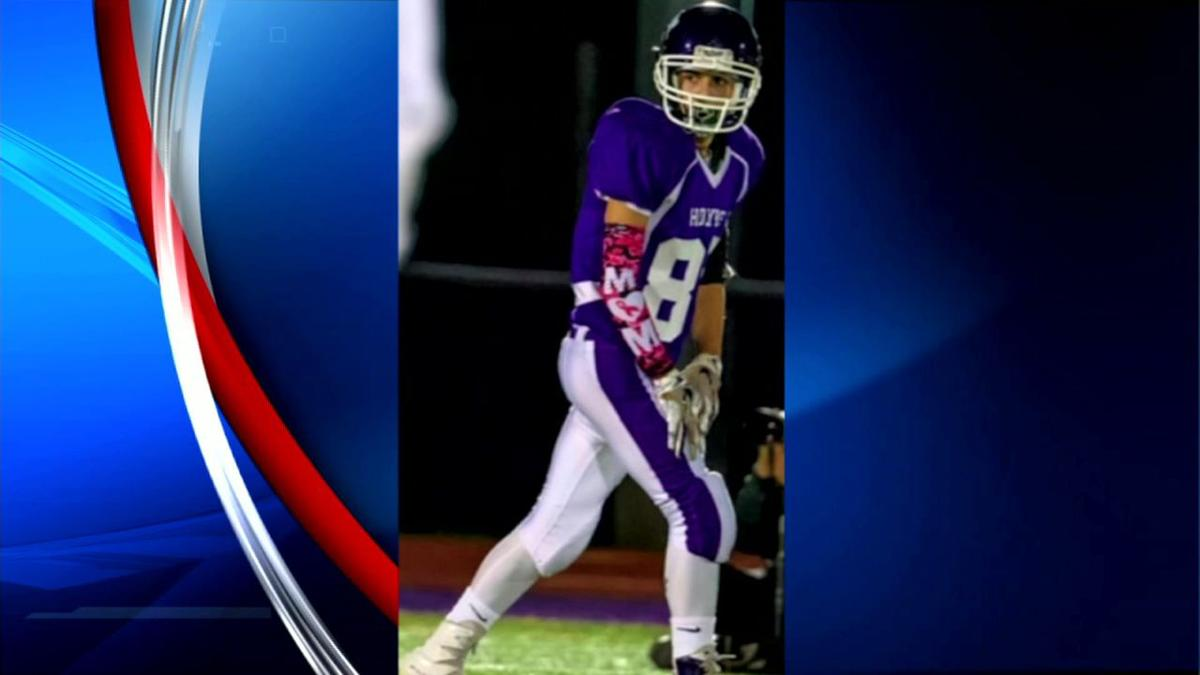 Holyoke football players honor breast cancer survivors