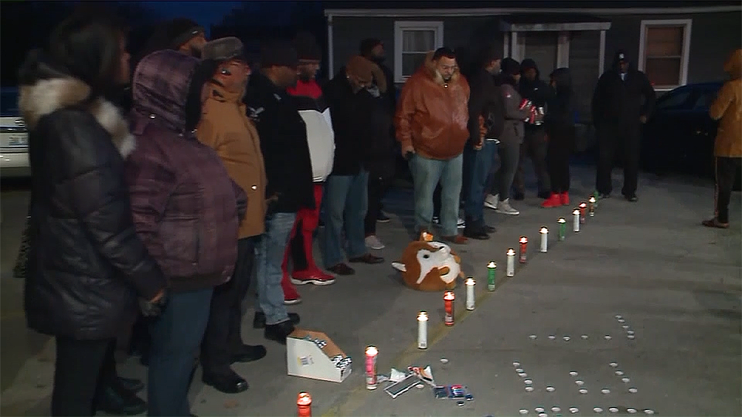 Vigil held for security guard shot, killed by police