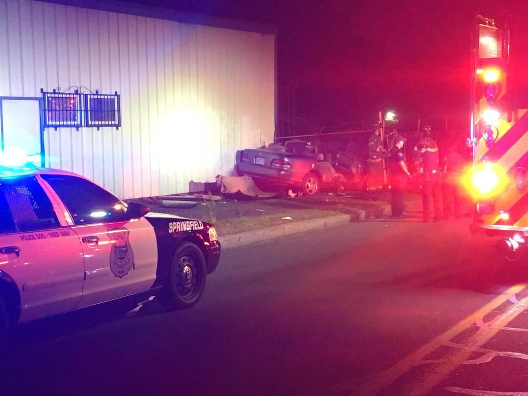 Two hospitalized after car crashes into building on Bay Rd