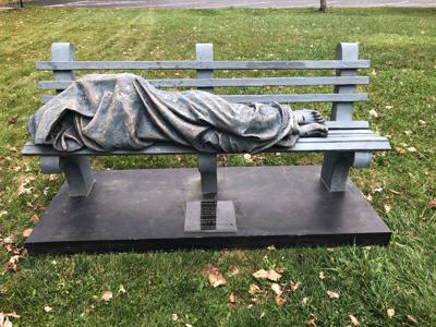 A realistic 'Homeless Jesus' statue sparks conversation -- and a visit from police