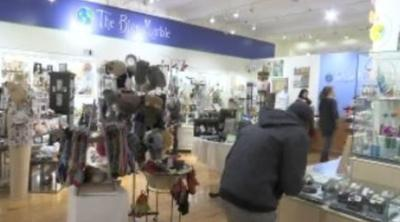 Shoppers look to small businesses for last-minute holiday shopping.