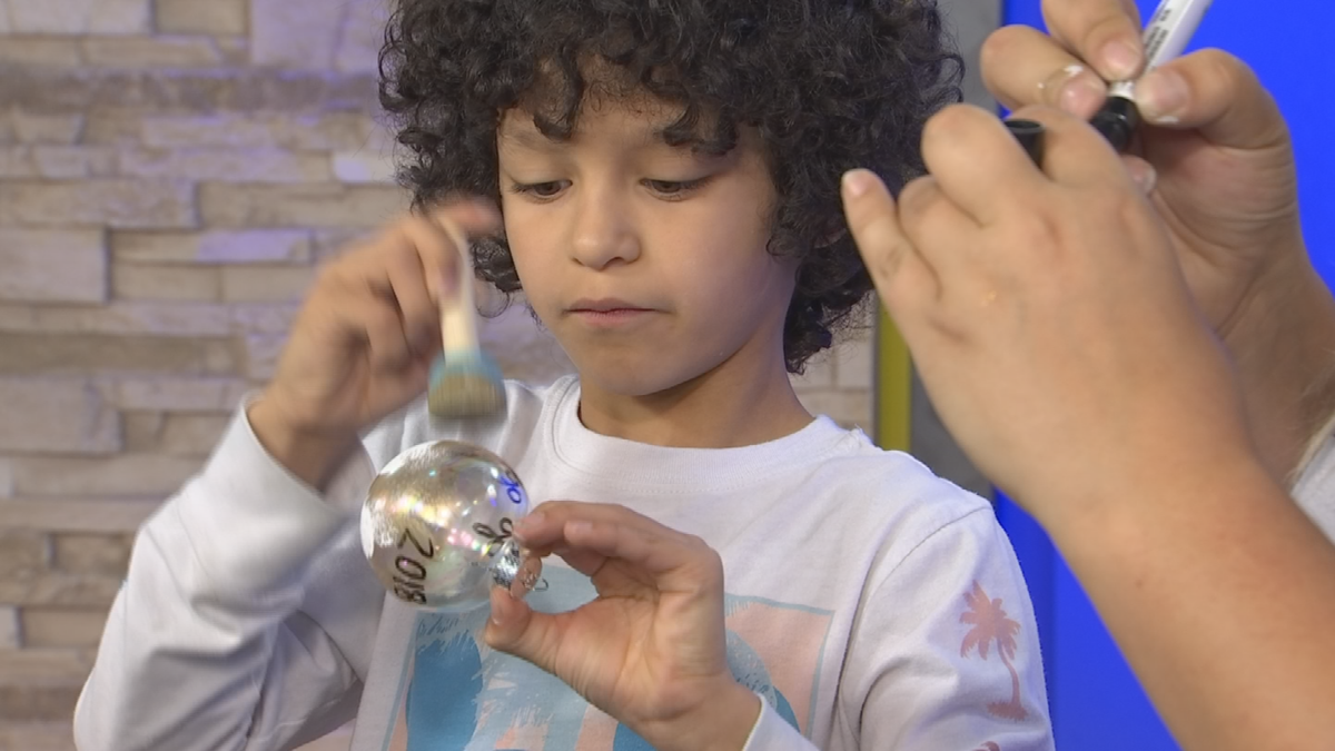 VIDEO: Young cancer survivor sells ornaments for a cause