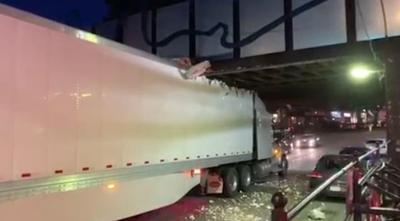 Main St. in Northampton reopened after tractor trailer becomes stuck under overpass.